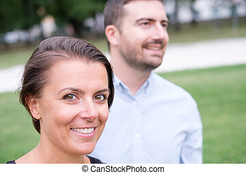 Couple of man and woman together portrait outdoor looking at the camera