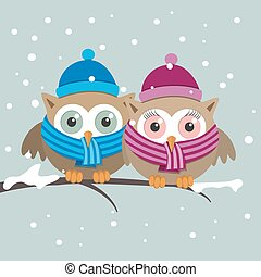 Couple of owls with scarf on a winter day