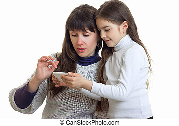 couple of pother and daughter looking a photos on a mobile phone