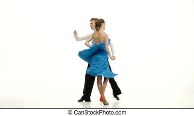 Couple of professional dancers perform samba on white studio...