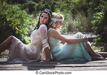 couple of romantic style women outdoor shot - couple of...