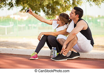 Couple of runners taking a selfie