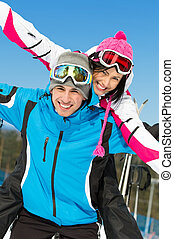 Couple of skiers have fun