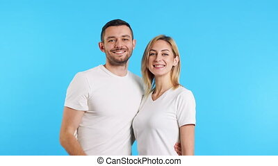 Couple of smiling happy man and woman showing thumbs up sign...