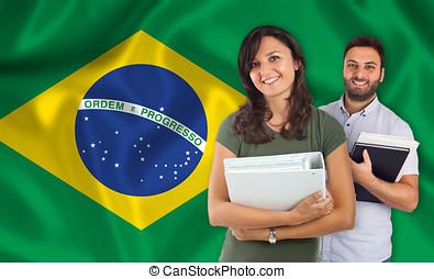 Couple of students over brazilian flag - Couple of young...