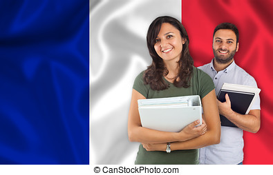 Couple of students over french flag