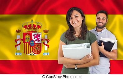 Couple of students over spanish flag - Couple of young...