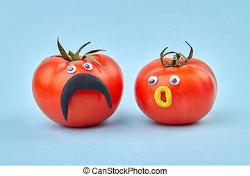 Couple of tomatoes with funny faces. Concept of healthy ...