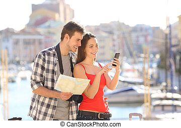 Couple of tourists checking online information on vacation
