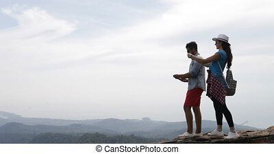 Couple Of Tourists Taking Photo Of Landscape From Mountain...