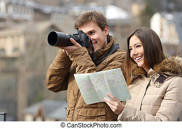 Couple of tourists taking photos with a dslr camera