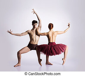 Couple of young and athletic ballet dancers