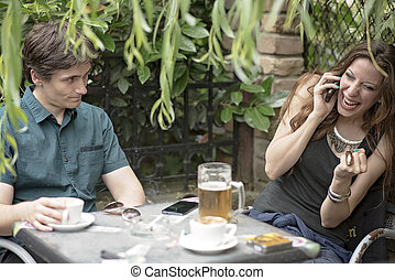 Couple on a bad date, woman ignoring man