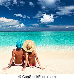 Couple on a beach at Maldives - Couple on a tropical beach ...