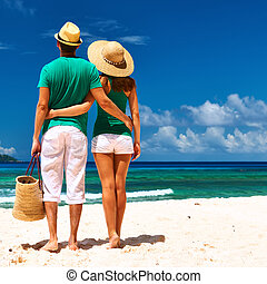 Couple on a beach at Seychelles - Couple relaxing on a ...