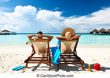 Couple on a beach - Couple on a tropical beach at Maldives