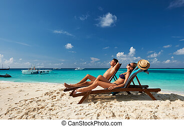 Couple on a beach - Couple on a tropical beach at Maldives