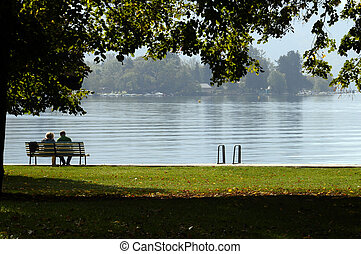 Couple on a bench at Annecy lake , France
