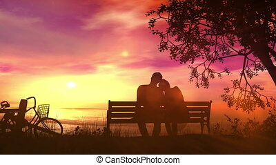 Couple on a bench watching the ocean after a bike ride