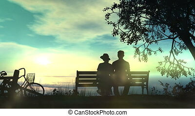 Couple on a bench watching the ocean