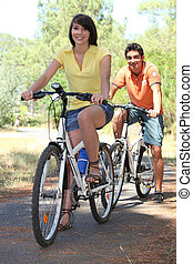 Couple on a bike ride in the countryside
