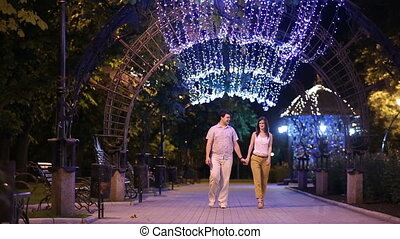 Couple on a date walking at evening city