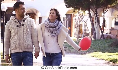 Couple on a date - Young couple holding their hands and...
