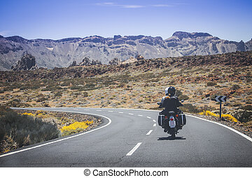 couple on a motorcycle traveling