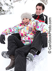 Couple on a sledge