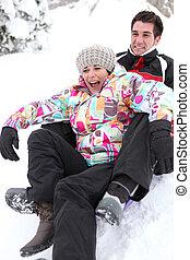 Couple on a sledge
