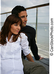 Couple on a terrace looking away