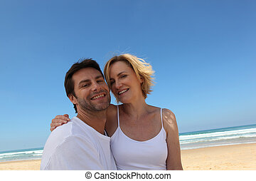 Couple on an empty beach