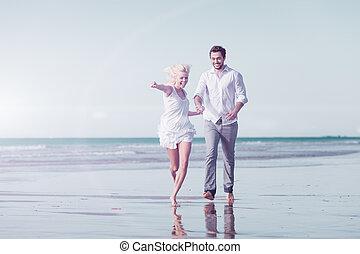 Couple on beach in honeymoon vacation