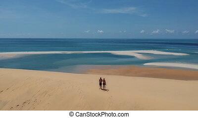 Couple on Beach to Stunning Seascape Panorama