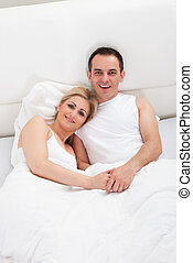 Couple On Bed Together