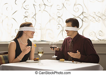 Couple on blind date. - Mid adult Caucasian couple dining in...