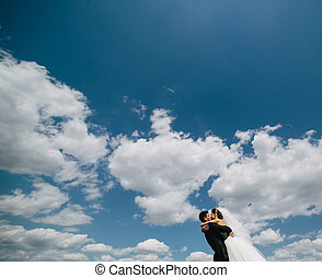 couple on blue sky background