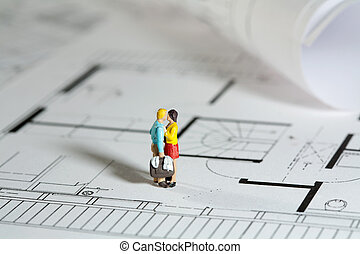Couple on Blueprint - New home concept with tiny miniature...
