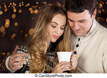 Couple on blurred lights background