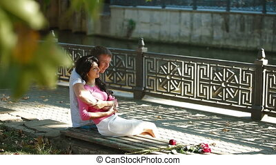 Couple on city park bench