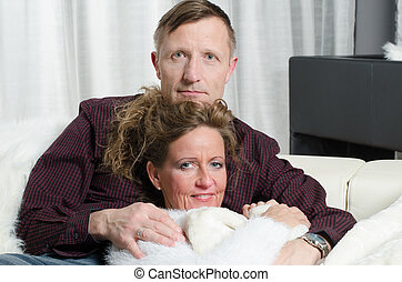 couple on couch having free time