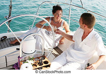 Couple on cruise. - Happy bride and groom on a luxury yacht.