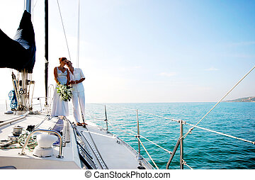 Couple on cruise. - Happy couple relaxing on a luxury yacht.