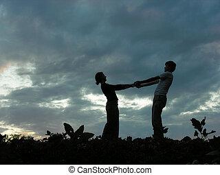 couple on evening sky