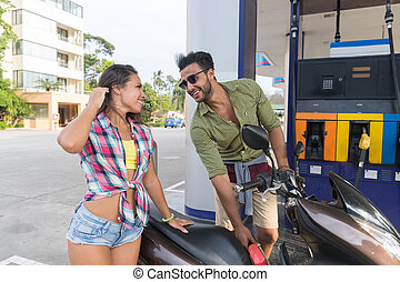 Couple On Gas Station Man Fuel Motor Bike, Happy Smiling Hispanic Guy