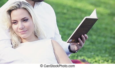 Couple on lawn reading
