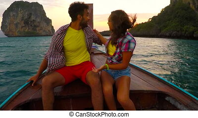 Couple On Long Tail Boat Nose At Sunset POV, Young Man And Woman Taking Tourists Mix Race On Vacation