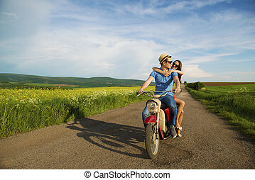 Couple on motorbike - Happy young couple in love on retro...