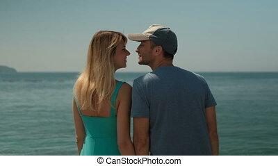 Couple on photo shoot on seaside walking, kissing, enjoy...