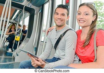 Couple on public transport